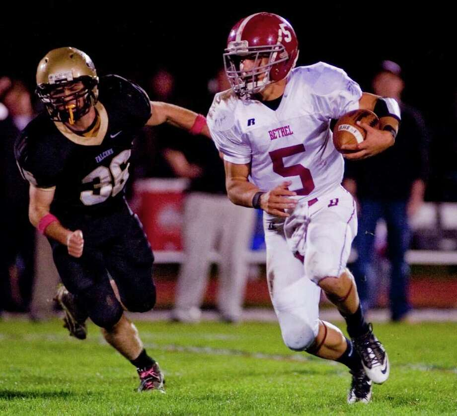 Bethel High School quarterback Brandon Schmidt runs the football in a game against Joel Barlow, played at Barlow. Friday, Oct. 21, 2011 Photo: Scott Mullin / The News-Times Freelance