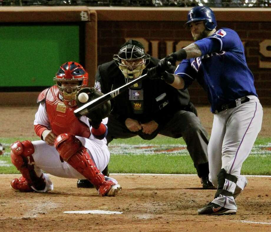 JEFF ROBERSON : ASSOCIATED PRESS POWER GAME: When the Rangers' Mike Napoli hit a two-run homer against the Cardinals in Game 1 of the World Series, many expected it to be the first of many home runs this matchup would produce, but runs have proved difficult to come by. Photo: Jeff Roberson / AP