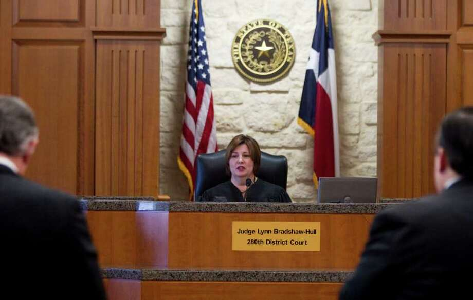Judge Lynn Bradshaw-Hill listens to arguments in a portion of the Brown divorce proceedings Friday, Oct. 21, 2011, in Houston. Photo: Brett Coomer, Houston Chronicle / © 2011 Houston Chronicle