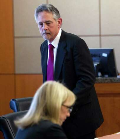 Michael DeBruin, left, attorney for former hand surgeon Michael Brown, stands in the courtroom during a hearing. Photo: Brett Coomer, Houston Chronicle / © 2011 Houston Chronicle
