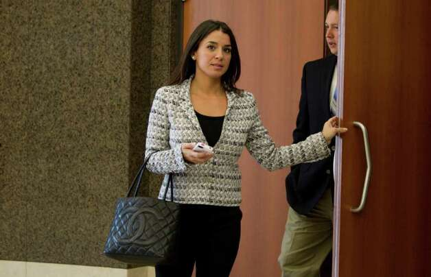 Rachel Brown, left, estranged wife of former hand surgeon Michael Brown leaves the courtroom following a hearing. Photo: Brett Coomer, Houston Chronicle / © 2011 Houston Chronicle