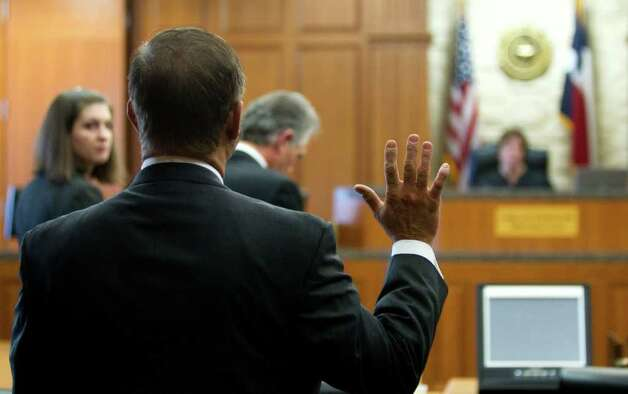 Michael Brown swears in during a hearing Friday, Oct. 21, 2011, in Houston. Photo: Brett Coomer, Houston Chronicle / © 2011 Houston Chronicle