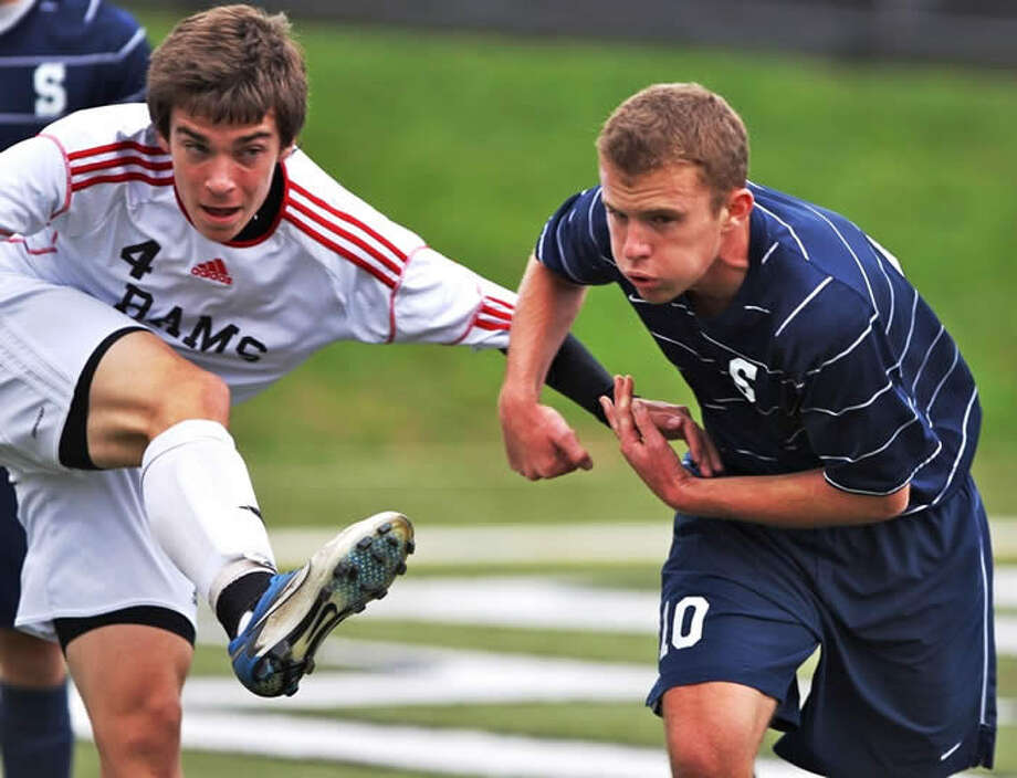 Staples' Dylan Evans, right, and New Canaan's battle for position Friday in Staples' 1-0 victory. Photo: Carl McNair / Contributed Photo