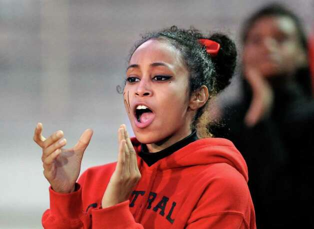 Bridgeport Central High School cheerleader Ariel Jackson leads the cheering during football game between Greenwich High School and Bridgeport Central High School at Kennedy Stadium, Bridgeport, Friday night, Oct. 21, 2011. Photo: Bob Luckey / Greenwich Time