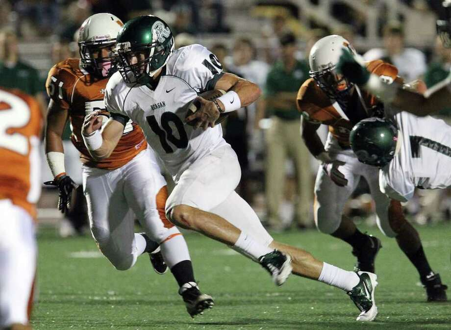Reagan quarterback Trevor Knight (10) finds an opening to run for a touchdown in the first quarter against Madison in the first half of football at Comalander Stadium on Friday, Oct. 21, 2011. Kin Man Hui/kmhui@express-news.net Photo: Kin Man Hui, ~ / San Antonio Express-News