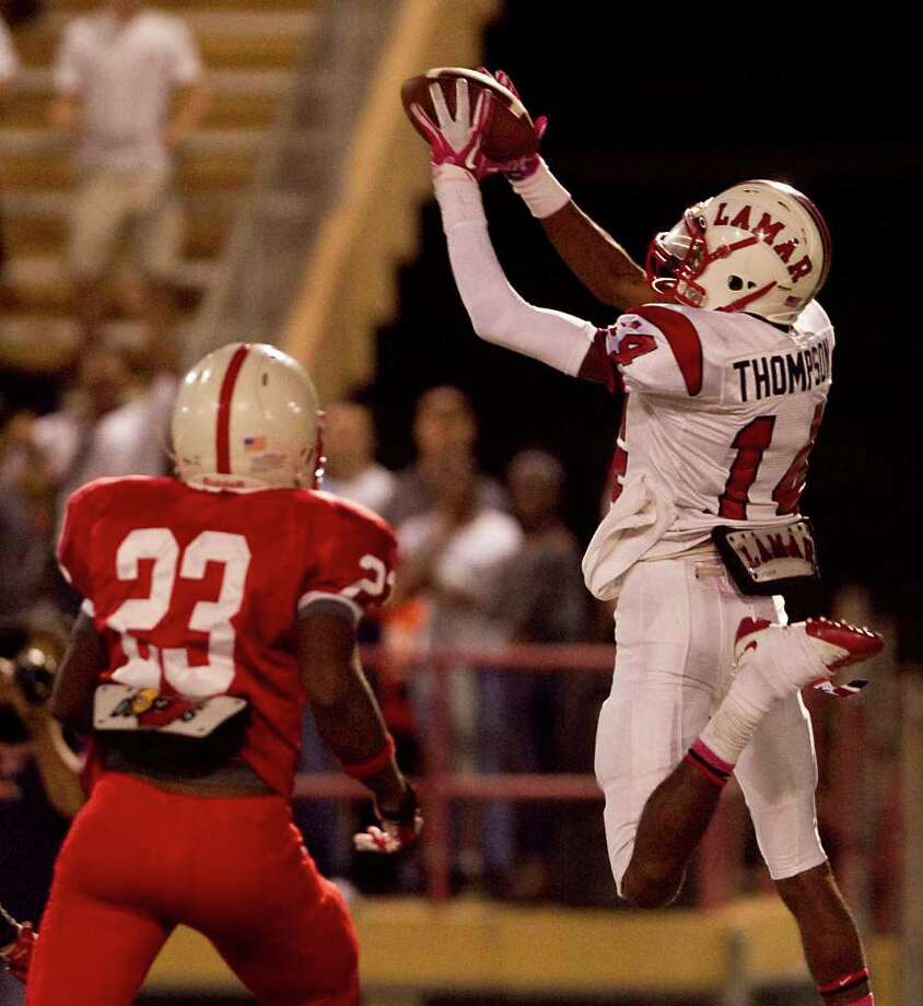 Oct. 21:Lamar 20, Bellaire 16. Lamar's Carrington Thompson makes the game-winning touchdown catch as he gets behind Bellaire's Jacoby Pringle (23) during the fourth quarter of Friday's gameat Butler Stadium. Photo: Nick De La Torre, Houston Chronicle / © 2011  Houston Chronicle