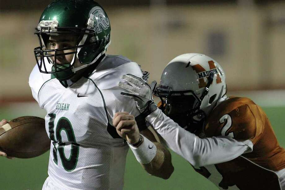 Reagan quarterback Trevor Knight (10) gets pushed out of bounds by Madison's Marquis Warford (02) in the second half of football at Comalander Stadium on Friday, Oct. 21, 2011. Reagan defeated Madison, 38-17. Kin Man Hui/kmhui@express-news.net Photo: Kin Man Hui, ~ / San Antonio Express-News