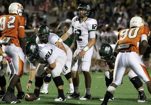 Reagan's Kyle Keller (12) takes over the quarterback spot after starter Trevor Knight went out of the game after an injury against Madison in the second half of football at Comalander Stadium on Friday, Oct. 21, 2011. Reagan defeated Madison, 38-17. Kin Man Hui/kmhui@express-news.net Photo: Kin Man Hui, ~ / San Antonio Express-News