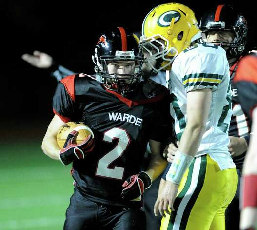 Ryan Jacob of Fairfield Warde High School, # 2, after making an interception during high school football game between Fairfield Warde High School and Trinity Catholic High School, at Fairfield Warde, Friday night, Oct. 21, 2011. Rushing is # 68 George Li, # 68 of Trinity Catholic. Photo: Bob Luckey / Greenwich Time