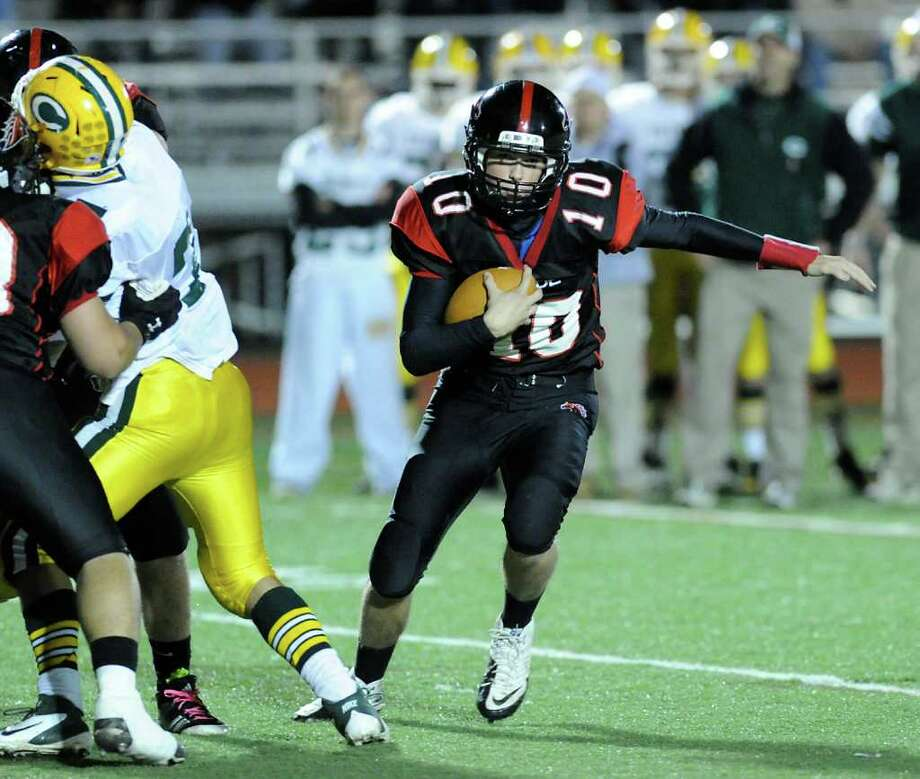 QB Chris Foley, # 10 of fairfield Warde High School runs during high school football game between Fairfield Warde High School and Trinity Catholic High School, at Fairfield Warde, Friday night, Oct. 21, 2011. Photo: Bob Luckey / Greenwich Time