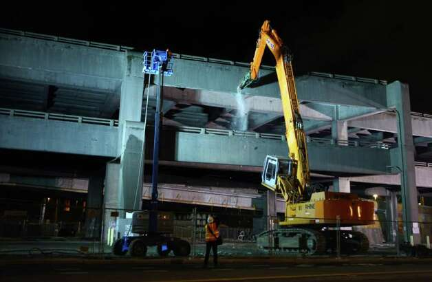 The Alaskan Way Viaduct demolition operation begins. The south section of the elevated highway is being  demolished to make way for a new highway that will lead into a deep-bore  tunnel under the Seattle waterfront. Photo: JOSHUA TRUJILLO / SEATTLEPI.COM