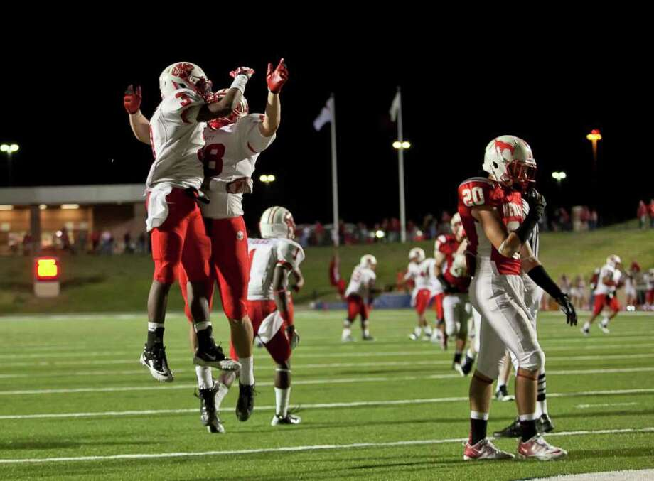 Katy wide receiver Jordan Thompson (3) celebrates his touchdown reception with teammate Stein Spiller (88) as the Tigers take on Memorial in the second half Friday evening October 21, 2011 at Derrell Tully Stadium. As two of the area's top 10 teams (Katy is No. 1) met in the biggest 19-5A game of the year so far at Memorial's home-coming game. Final score 45-0 Katy.   Nathan Lindstrom/Special to the Chronicle  ©2011 Nathan Lindstrom Photo: Nathan Lindstrom, Freelance / ©2011 Nathan Lindstrom