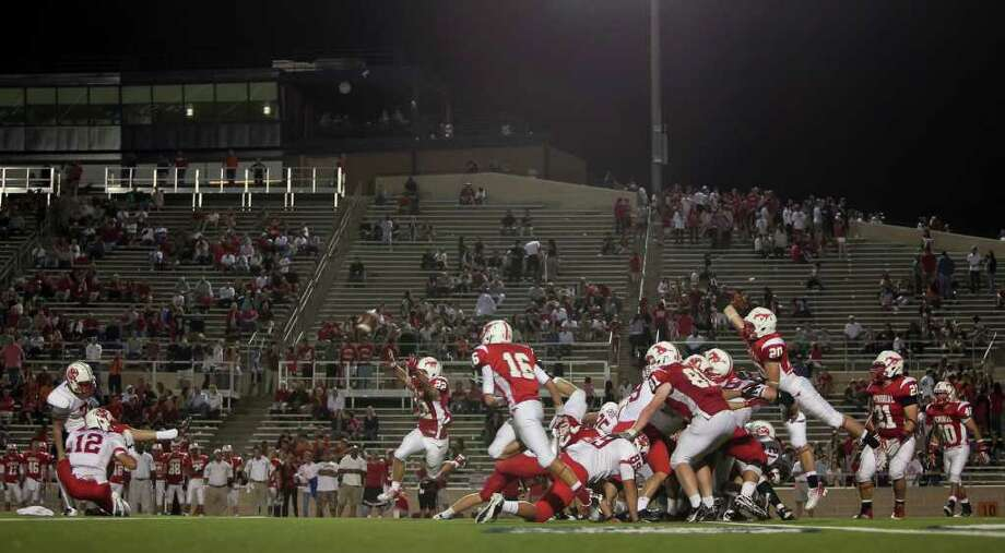 Katy kicker David Beckendorff (7) kicks a field goal to put the Tigers up 38-0 against Memorial in the second half Friday evening October 21, 2011 at Derrell Tully Stadium. As two of the area's top 10 teams (Katy is No. 1) met in the biggest 19-5A game of the year so far at Memorial's home-coming game. Final score 45-0 Katy.