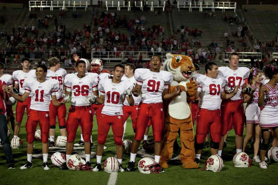 The Katy Tigers celebrate their win against Memorial Friday evening October 21, 2011 at Derrell Tully Stadium. As two of the area's top 10 teams (Katy is No. 1) met in the biggest 19-5A game of the year so far at Memorial's home-coming game. Final score 45-0 Katy.