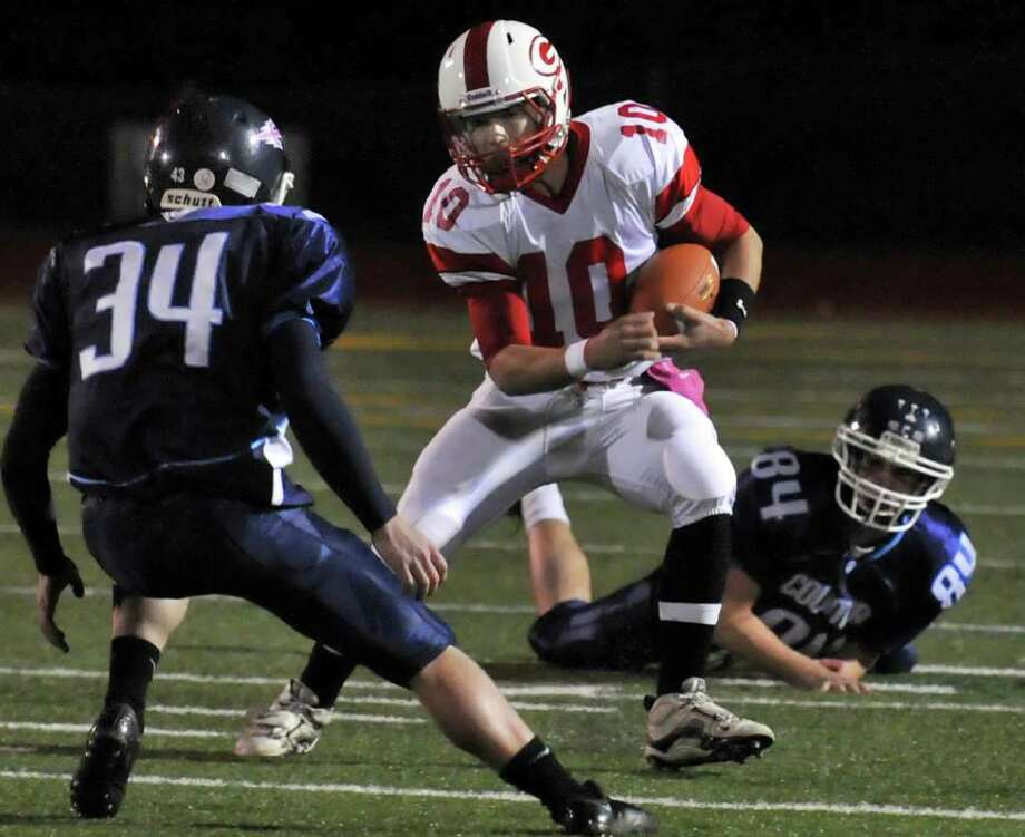 Guilderland quarterback #10 Timothy O'Connor, center, gets through two Columbia defenders in the Class AA quarterfinal football game in East Greenbush Friday October 21, 2011.    (John Carl D'Annibale / Times Union) Photo: John Carl D'Annibale / 00015044A