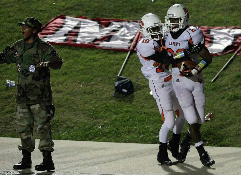 La Porte 38, North Shore 30. La Porte's Johnathan Lewis (right) celebrates his 40yard touchdown run with teammate Devan Gay as North Shore AFJROTC student Quinton Ashe disagrees with the call during the second half of a high school football game, Friday, October 21, 2011 at Galena Park Stadium in Houston. Photo: Eric Christian Smith, For The Chronicle