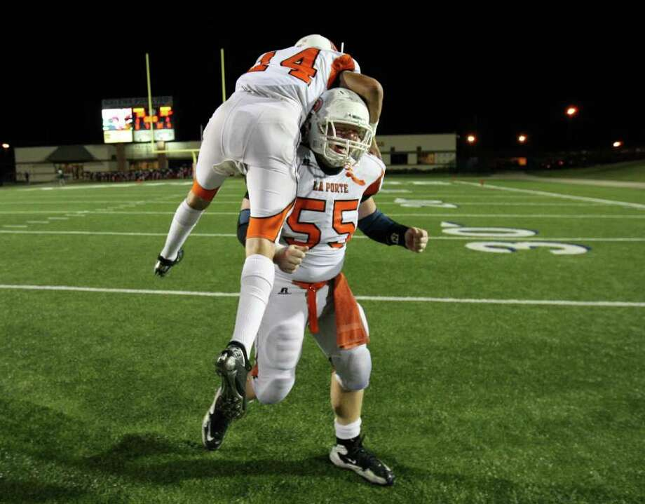 La Porte's Justin King (55) celebrates with teammate Josh Vidales the Bulldogs' 38-30 victory over North Shore, Friday, October 21, 2011 at Galena Park Stadium in Houston. Photo: Eric Christian Smith, For The Chronicle
