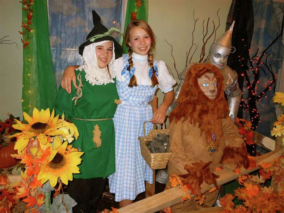 """Tori Guasco as the Scarecrow and Julia Wilson as Dorothy from """"The Wizard of Oz"""" -- characters at the 18th annual Enchanted Castle in the Burr Homestead. Photo: Mike Lauterborn / Fairfield Citizen contributed"""