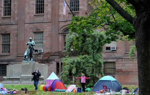 Megan Hanson and 6-year-old Sonia Russell walk about after spending the night in the family section of the Occupy Albany encampment at Academy Park  across from the Capitol in Albany, NY Saturday, Oct. 22, 2011.( Michael P. Farrell/Times Union) Photo: Michael P. Farrell