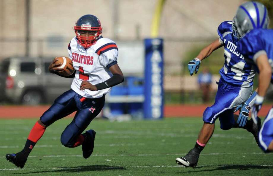 Brien McMahon's Trevon Forney carries the ball as Fairfield Ludlowe defenders move in Saturday, Oct. 22, 2011 during their football game at Taft Field in Fairfield, Conn. Photo: Autumn Driscoll / Connecticut Post