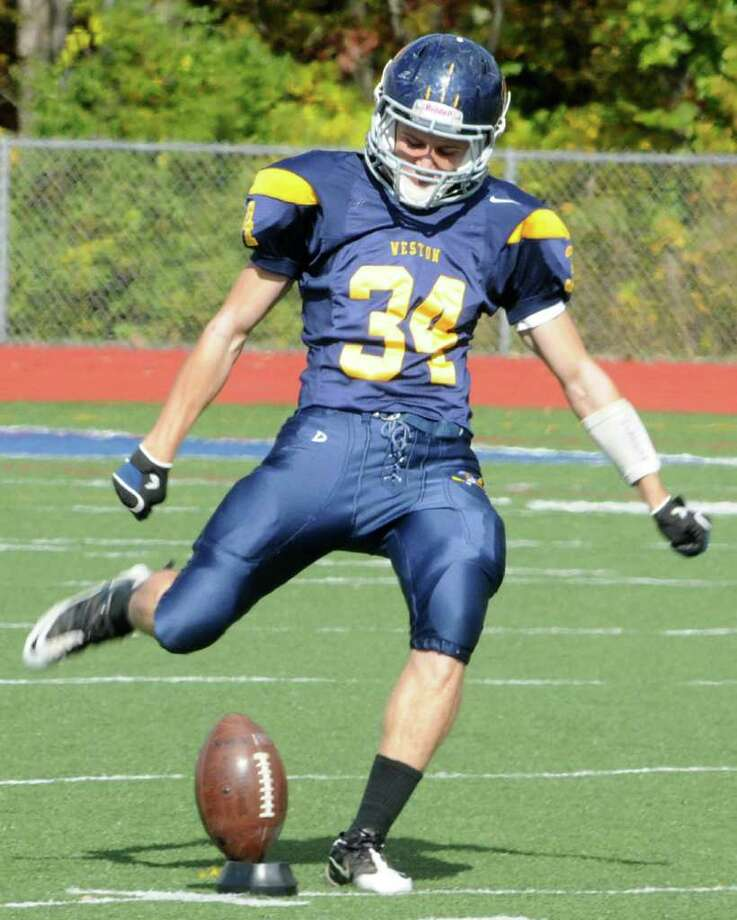 Weston's JD Simons starts the home game against Oxford with the kick off on Saturday Oct. 22, 2011. Photo: Lisa Weir / The News-Times Freelance