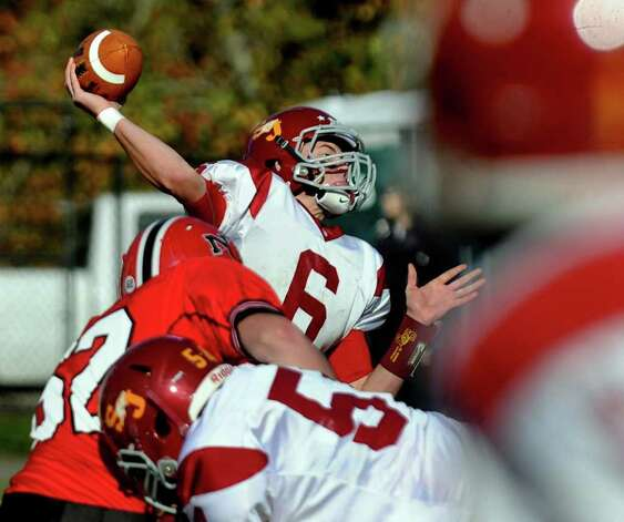St. Joseph's #6 Patrick Boyle passes the football, during boys football action against New Canaan in New Canaan, Conn. on Saturday October 22, 2011. Photo: Christian Abraham / Connecticut Post