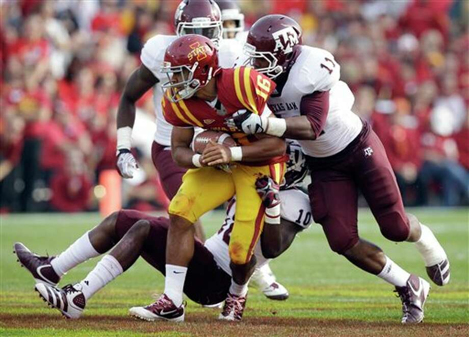 Iowa State quarterback Jared Barnett (16) is tackled by Texas A&M linebacker Sean Porter (10) and linebacker Jonathan Stewart (11) during the first half of an NCAA college football game, Saturday, Oct. 22, 2011, in Ames, Iowa. (AP Photo/Charlie Neibergall) Photo: Associated Press