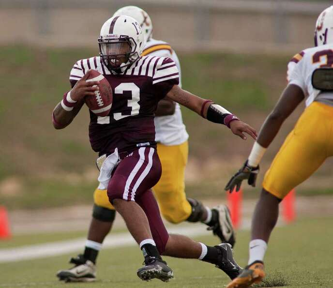 Tiger quarterback Riko Smalls (13) jukes to gain a first down in the first half as Texas Southern Un