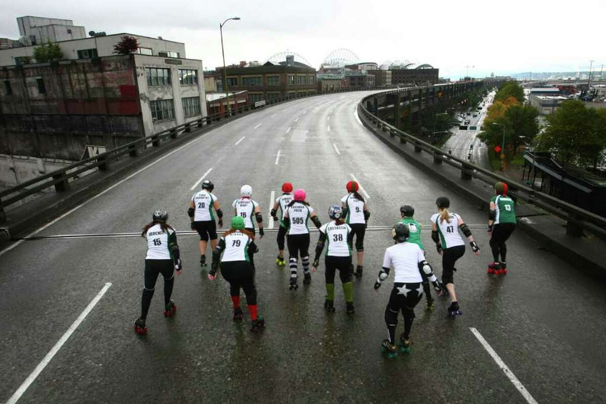 Members of the Rat City Rollergirls flat-track roller derby league skate on the upper deck of the closed Alaskan Way Viaduct on Saturday, October 22, 2011 in downtown Seattle. They were winners of a contest where organizations made pitches about what they would do on the deck of the closed highway for half an hour. The highway usually carries 110,000 cars per day and will be closed for nine days as demolition of the southern half of the aging structure begins. The highway, built in the 1950s, will be replaced with a new deep bore tunnel along the Seattle waterfront.