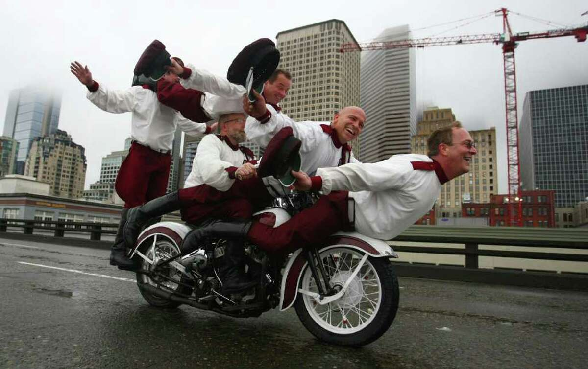 Members of the Seattle Cossacks classic motorcycle stunt team perform on the upper deck of the closed Alaskan Way Viaduct in downtown Seattle. They were winners of a contest where organizations made pitches about what they would do on the deck of the closed highway for half an hour. The Cossacks performed their signature tricks on the highway.