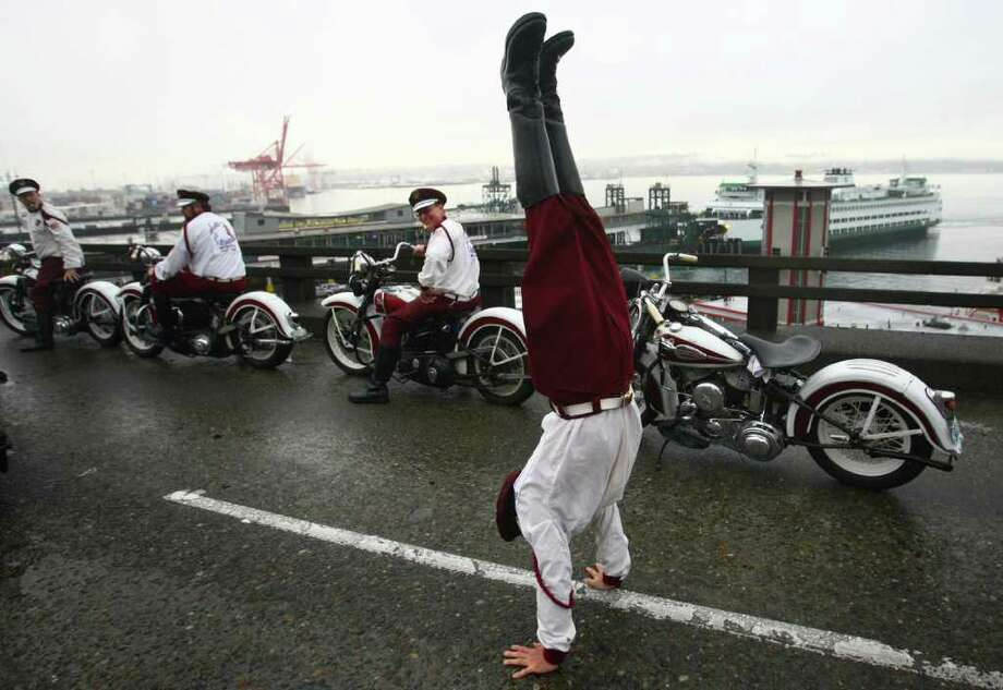 Members of the Seattle Cossacks classic motorcycle stunt team prepare to perform on the upper deck of the closed Alaskan Way Viaduct. Photo: JOSHUA TRUJILLO / SEATTLEPI.COM