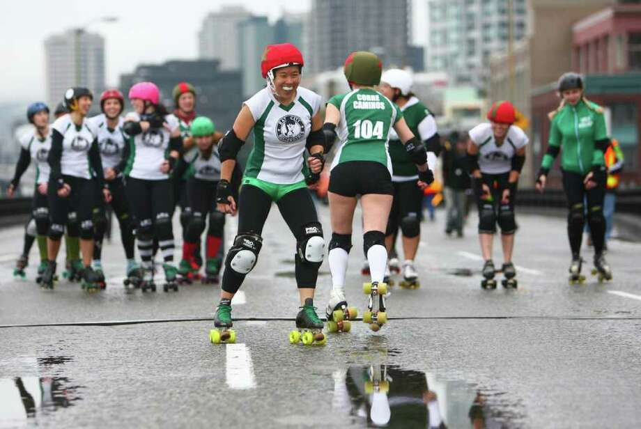 Members of the Rat City Rollergirls skate on the upper deck of the closed Alaskan Way Viaduct. Photo: JOSHUA TRUJILLO / SEATTLEPI.COM