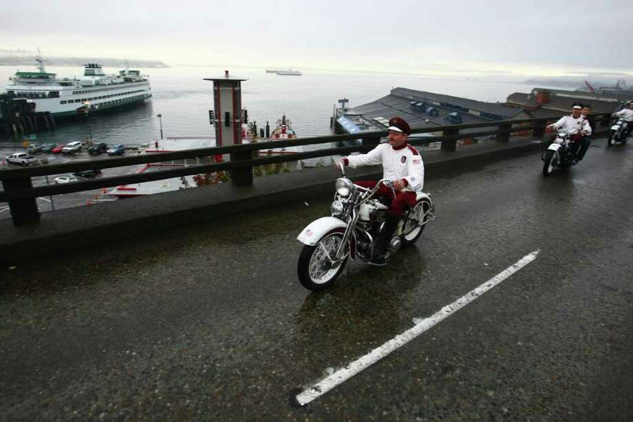 Members of the Seattle Cossacks classic motorcycle stunt team perform on the upper deck of the closed Alaskan Way Viaduct. Photo: JOSHUA TRUJILLO / SEATTLEPI.COM