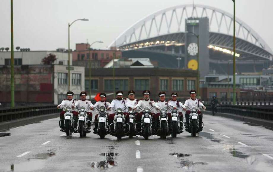 Members of the Seattle Cossacks classic motorcycle stunt team perform on the upper deck of the closed Alaskan Way Viaduct on Saturday. Photo: JOSHUA TRUJILLO / SEATTLEPI.COM