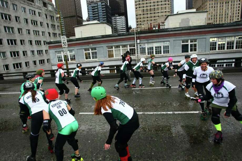 Members of the Rat City Rollergirls flat-track roller derby league skate on the upper deck of the closed Alaskan Way Viaduct. Photo: JOSHUA TRUJILLO / SEATTLEPI.COM