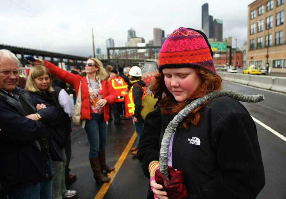 Zoey Salsbury, 14, of West Seattle, holds onto a piece of reinforcing steel she took as a souvenir of the Alaskan Way Viaduct on Saturday. Photo: JOSHUA TRUJILLO / SEATTLEPI.COM