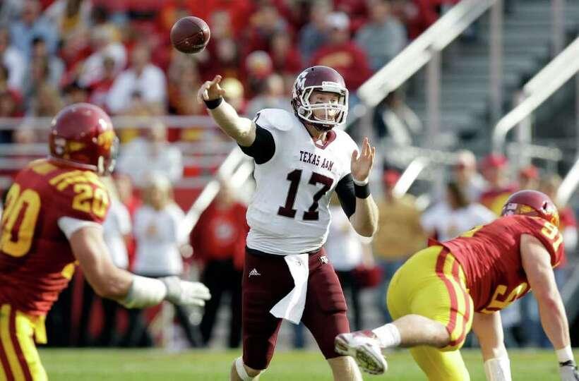 Texas A&M quarterback Ryan Tannehill (17) throws a pass during the first half of an NCAA college foo