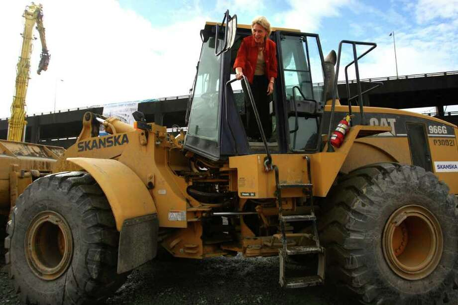 Governor Chris Gregoire steps out of a front-end-loader after she dumped rubble from the Alaskan Way Viaduct. Photo: JOSHUA TRUJILLO / SEATTLEPI.COM