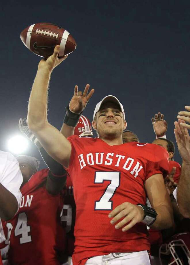 University of Houston quarterback Case Keenum (7) holds up a game ball for becoming the NCAA all time leader in total offense after winning a NCAA football game against Marshall University, Saturday, Oct. 22, 2011, at Robertson Stadium in Houston. Photo: Nick De La Torre, Houston Chronicle / © 2011  Houston Chronicle