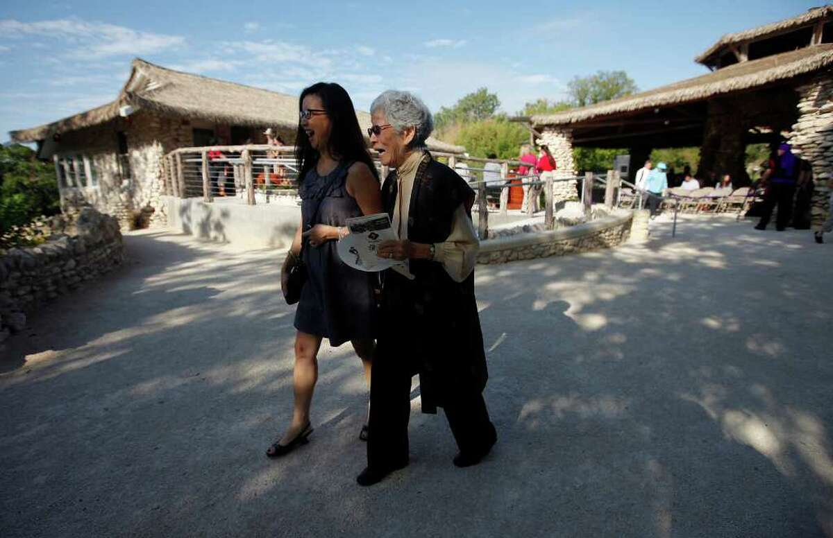 Mabel Jingu Enkoji, 86, laughs as she walks with her daughter, Peggy Nishio, on the grounds of the Japanese Tea Garden on Saturday, Oct. 22, 2011. They attended the grand re-opening ceremony of the Japanese Tea Garden after a $1.2 million renovation by the city. Guests of honor included members of the Jingu family such as Enkoji who once lived in the house. The house has been fully renovated and will be open for public use as well as offer food and drink services for visitors to the garden located near downtown.