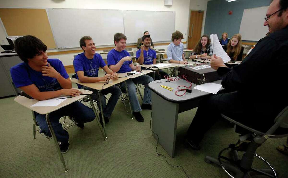 John Jay High School student competitors Alex Mackey (from left), James Juricka, Joe Langas, and Sharjeel Syed laugh to an errant attempted response to a quiz question during the first Alamo City Quiz Bowl at Trinity University on Saturday, Oct. 22, 2011. Teams consisted of four students competed against other teams in a game-show like fashion by pushing a buzzer to respond to questions from a variety of topics. Organizers hope this format with catch on in the city where decathlons have ruled the competition. The Jay students, who are part of the Science and Engineering Academy, won the round against students from Texas Military Institute.