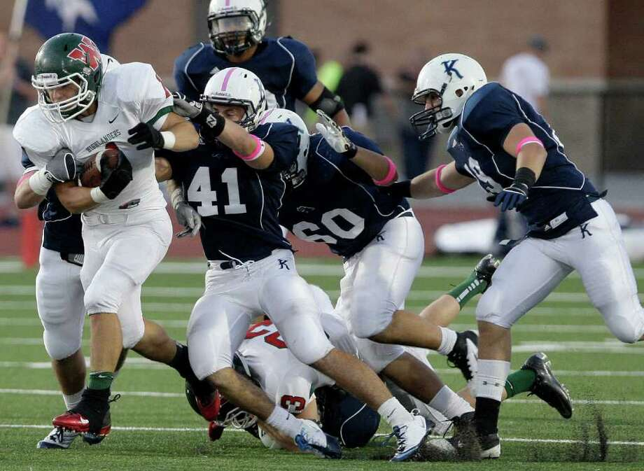 10/22/11: Running back Randy Cooper #1 of The Woodlands Highlanders runs through the Kingwood Mustangs dfense in a high school football game at Turner Stadium in Humble, Texas. For the Chronicle: Thomas B. Shea Photo: For The Chronicle: Thomas B. She