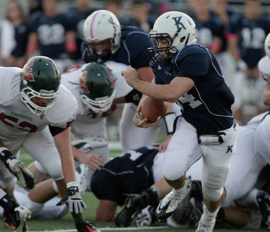 10/22/11: Quarterback Kade Harrington #84 of the Kingwood Mustangs runs the option against The Woodlands Highlanders  in a high school football game at Turner Stadium in Humble, Texas. For the Chronicle: Thomas B. Shea Photo: For The Chronicle: Thomas B. She