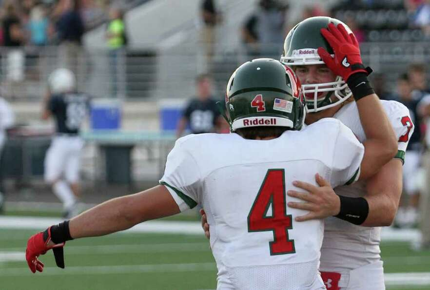 10/22/11: Wide receiver Christian Jauregui #4 is congratulated by quarterback Lance Miles #3 of The