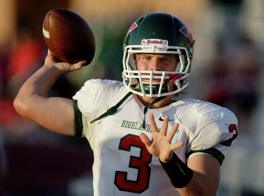 10/22/11: Quarterback Lance Miles #3 of The Woodlands Highlanders warms up on the sidelines before playing against the Kingwood Mustangs in a high school football game at Turner Stadium in Humble, Texas. For the Chronicle: Thomas B. Shea Photo: For The Chronicle: Thomas B. She