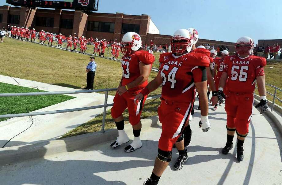 The Lamar Cardinals prepare to take the field before the game against Central Arkasas at the Provost Umphrey Stadium at Lamar in Beaumont, Saturday, October 22, 2011. Tammy McKinley/The Enterprise Photo: TAMMY MCKINLEY