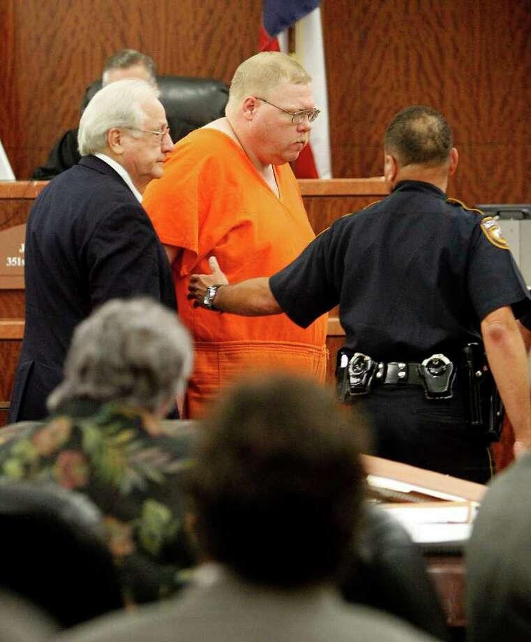 Steven Alexander Hobbs is led away after a hearing on Wednesday in Harris County Criminal Court. Photo: Karen Warren / © 2011 Houston Chronicle