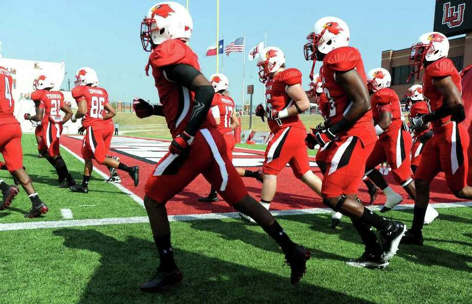 The Lamar Cardinals take the field before the homecoming game against Central Arkansas at the Provost Umphrey Stadium at Lamar in Beaumont, Saturday, October 22, 2011. Tammy McKinley/The Enterprise Photo: TAMMY MCKINLEY