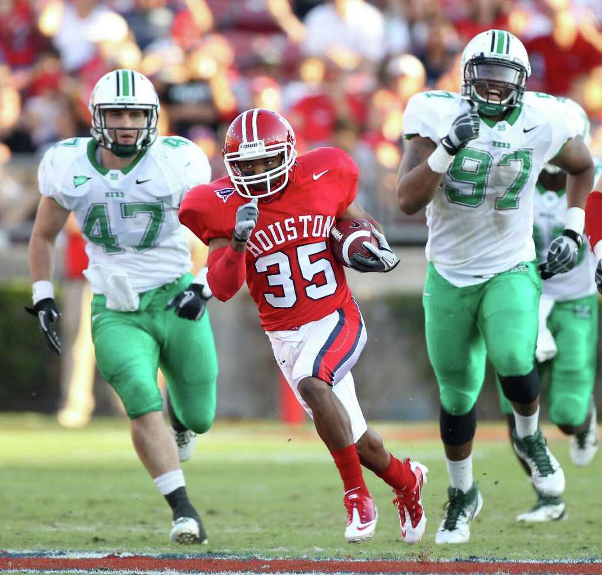 NICK de la TORRE: CHRONICLE THUNDERING AND LIGHTNING: Marshall's Tyson Gale (47) and Marques Aiken (97) find UH offensive players like Tyron Carrier will run you ragged if given the chance.