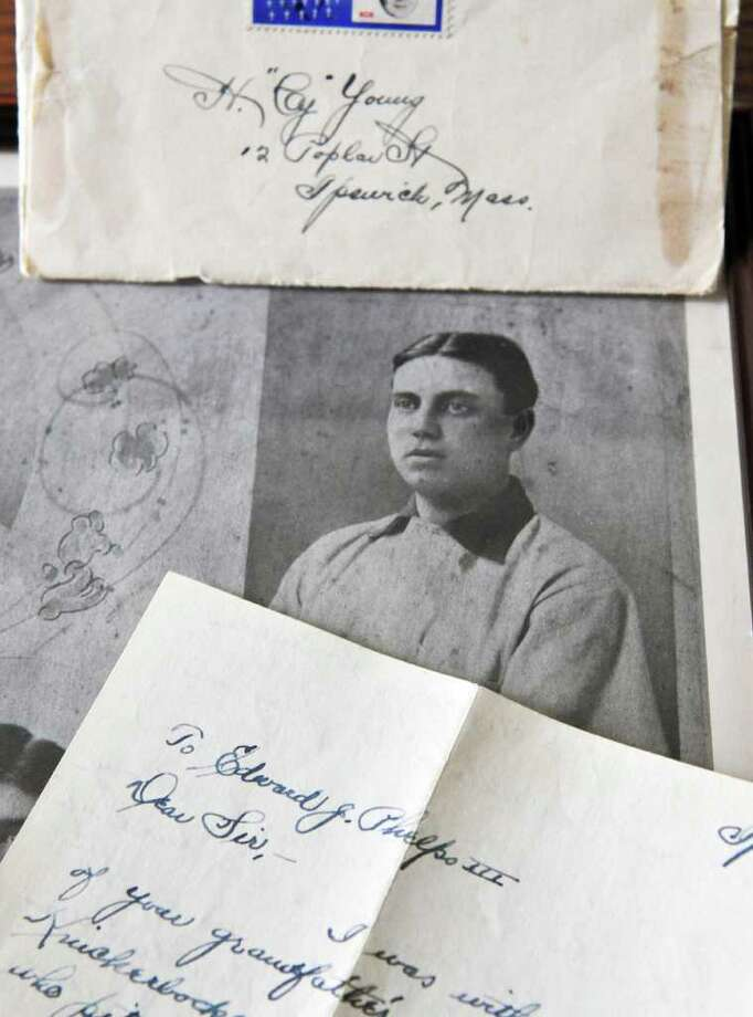Ed Phelps, who was a catcher for the Pirates and played in the first ever World Series in 1903, and a letter to him from Cy Young, in the collection of Phelps' granddaughter Mary Phelps Bombard at her Nassau home Tuesday October 18, 2011.   (John Carl D'Annibale / Times Union) Photo: John Carl D'Annibale / 00015011A